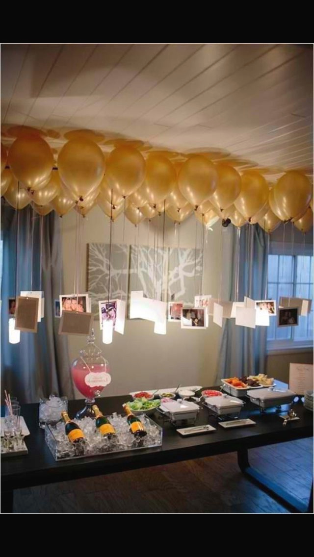 Balloons With Pictures Attached Over Tables Birthday